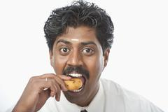 Stock Photo of South Indian businessman having vada