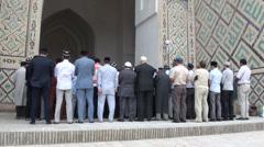 Friday prayer in Bukhara's Kalon mosque, Uzbekistan Stock Footage