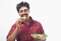 South Indian man having vada Stock Photos