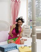 Woman choosing cloths and bangles - stock photo