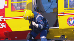 Westpac Lifesaver1 Rescue Helicopter searches coast line PT4 Stock Footage