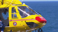 Westpac Lifesaver1 Rescue Helicopter searches coast line PT5 - stock footage