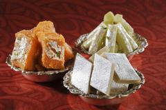 Stock Photo of Close-up of bowls of traditional Indian sweets