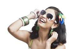 Beautiful young woman posing with sunglasses Stock Photos