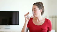 Stock Video Footage of Young Woman Drinking A Glass of Water