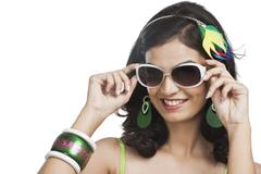 Beautiful young woman posing with sunglasses - stock photo