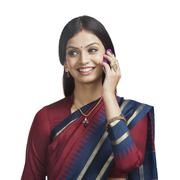 Traditionally Indian woman talking on a cell phone - stock photo