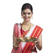 Stock Photo of Traditional Bengali woman holding pooja thali