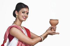 Traditional Bengali woman praying Stock Photos