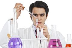 Male scientist doing scientific experiment in a laboratory Stock Photos