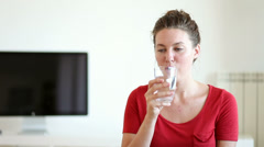 Young Woman Drinking A Glass of Water - stock footage