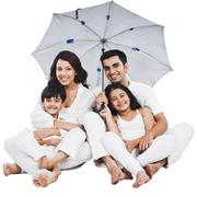 Portrait of a happy family sitting under an umbrella - stock photo