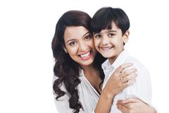 Portrait of a happy mother and son Stock Photos