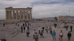 acropolis old temple of athena and Parthenon, plenty of tourists - stock footage