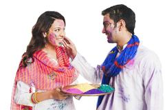 Couple celebrating Holi festival - stock photo