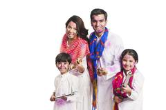 Stock Photo of Family celebrating Holi festival