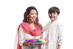 Woman celebrating Holi festival with her son - stock photo
