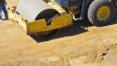 Roller compactor at road construction site - stock video Stock Footage