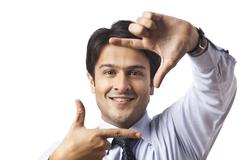 Businessman gesturing and smiling - stock photo