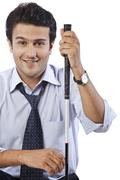Portrait of a businessman smiling with holding a golf club - stock photo