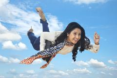 Businesswoman flying with a laptop Stock Photos