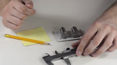 Measuring calipers two metal cylinders Stock Footage