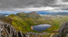 panoramic view of scottish highlands, mountains in loch assynt - stock photo