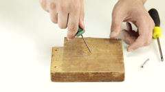 Screwing screw into wood Stock Footage