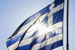 Stock Photo of Greek flag fluttering against the blue sky, Athens, Greece
