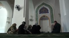 Women praying in Uzbek mosque Stock Footage
