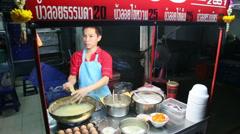 Street Vendor Cooking Thai Dumplings in Thailand Stock Footage
