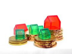 houses and coins property investment concept - stock photo
