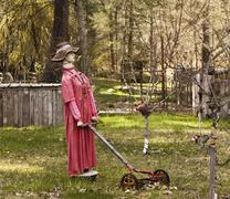 Scarecrow with lawnmower Stock Photos