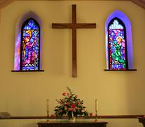 church interior with stained glass windows - stock photo