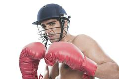Portrait of a male boxer practicing boxing - stock photo