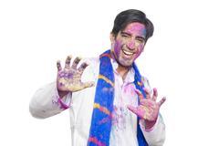 Stock Photo of Portrait of a man celebrating Holi