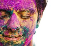 Mans face covered with powder paint during Holi festival Stock Photos