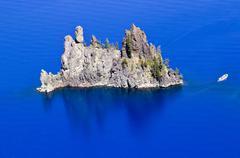 phantom ship island blue crater lake reflection white boat oregon - stock photo