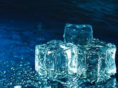 iced water against abstract blue backgrounds for your design - stock photo