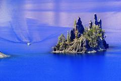 phantom ship island boat crater lake reflection blue sky oregon - stock photo