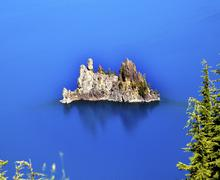 phantom ship island crater lake reflection blue sky oregon - stock photo