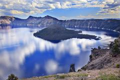 wizard island crater lake reflection clouds blue sky oregon - stock photo