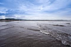 Waves on the beach, Alibag, Raigad District, Konkan, Maharashtra, India - stock photo