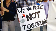 """""""We Are People Not Terrorists"""" Rally Sign Stock Footage"""