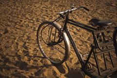 Cycle rickshaw on sand, Pushkar, Ajmer, Rajasthan, India Stock Photos