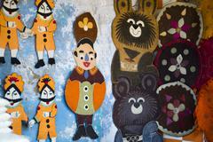 Close-up of decorative wall hangings for sale at Pushkar Camel Fair, Pushkar, - stock photo