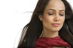 Woman day dreaming with her eyes closed - stock photo