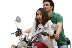 Couple riding a motorcycle Stock Photos