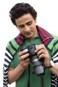 Male photographer holding a camera Stock Photos