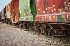 Freight train cars on tracks Stock Photos